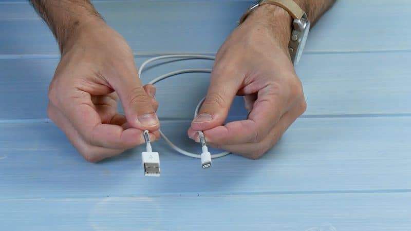 Wrap a spring around the cable directly below both plugs