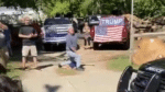 Video shows man with Trump banner