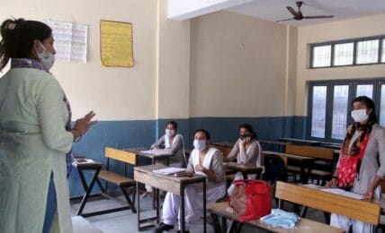 Students attend a class at Government School after schools reopened partially